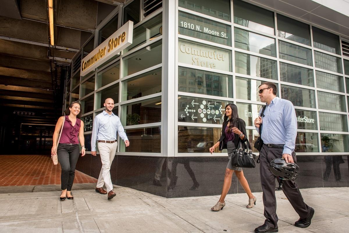 four business people walking near the commuter store in rosslyn, virginia