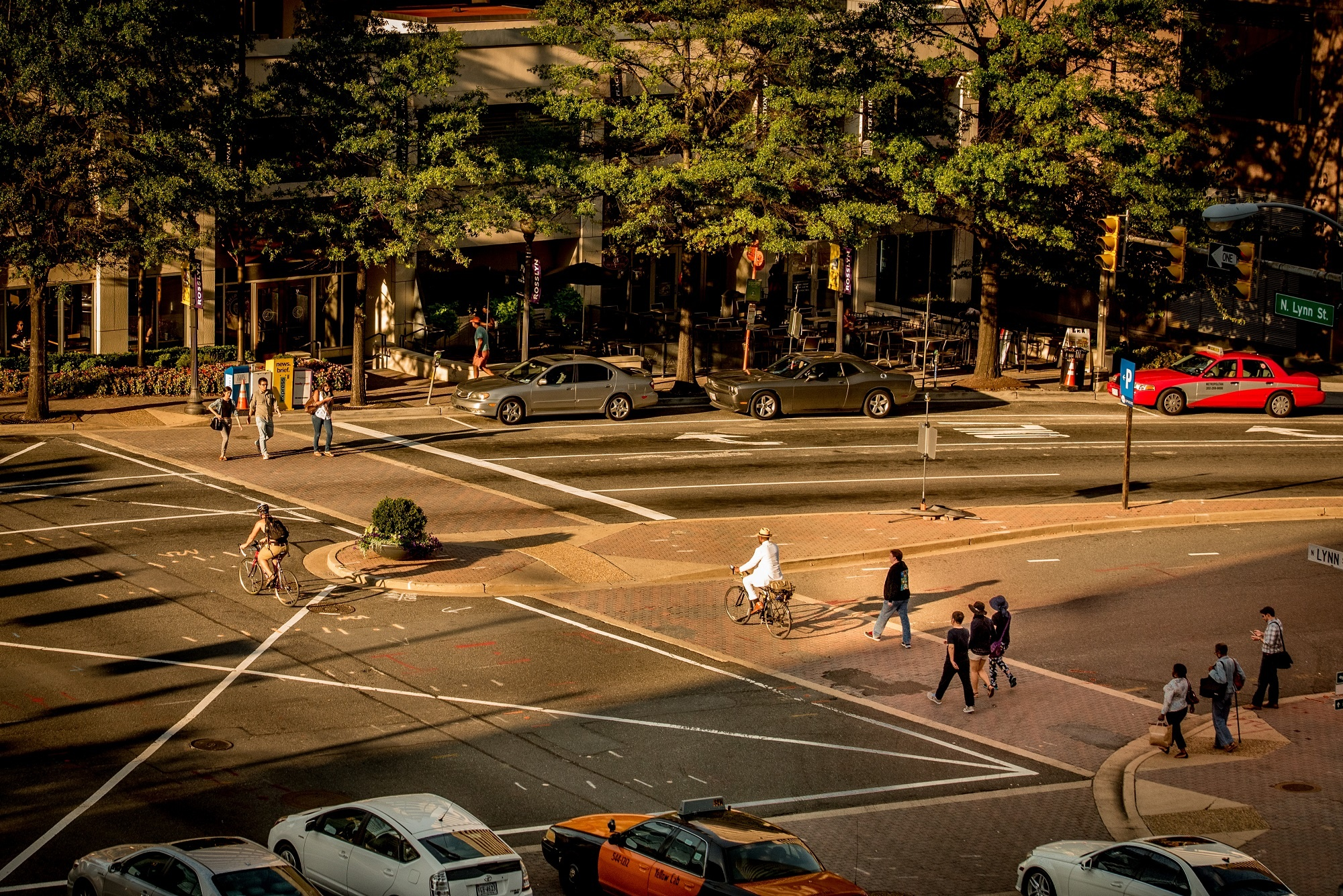 Pedestrians, bikers, and cars sharing the road