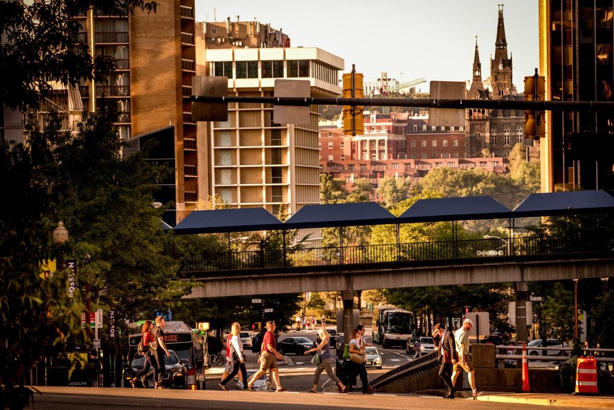 People Walking And Pedestrian Bridge